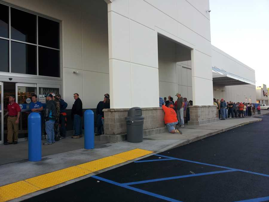 There are two separate lines at the store. We are told one line is for the free bike. Those in the other line say they are there to buy ammunition. There is a 3 box limit on ammunition and each box must be a different caliber.