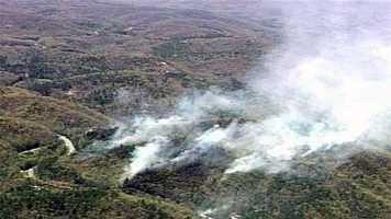 Several smoky fires burned acres of brush along a North Carolina highway Friday.