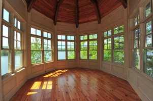 The home features an authentic stone lighthouse designed to provide views from all three levels of the home.