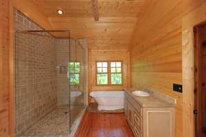 It has six bedrooms and three full bathrooms and three half baths.
