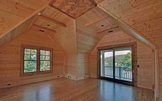 The estate has a massive grand room with a 24 foot vaulted ceiling.