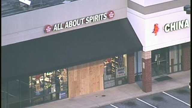 This shot of the store, All About Spirits, show the front boarded where the crashed.