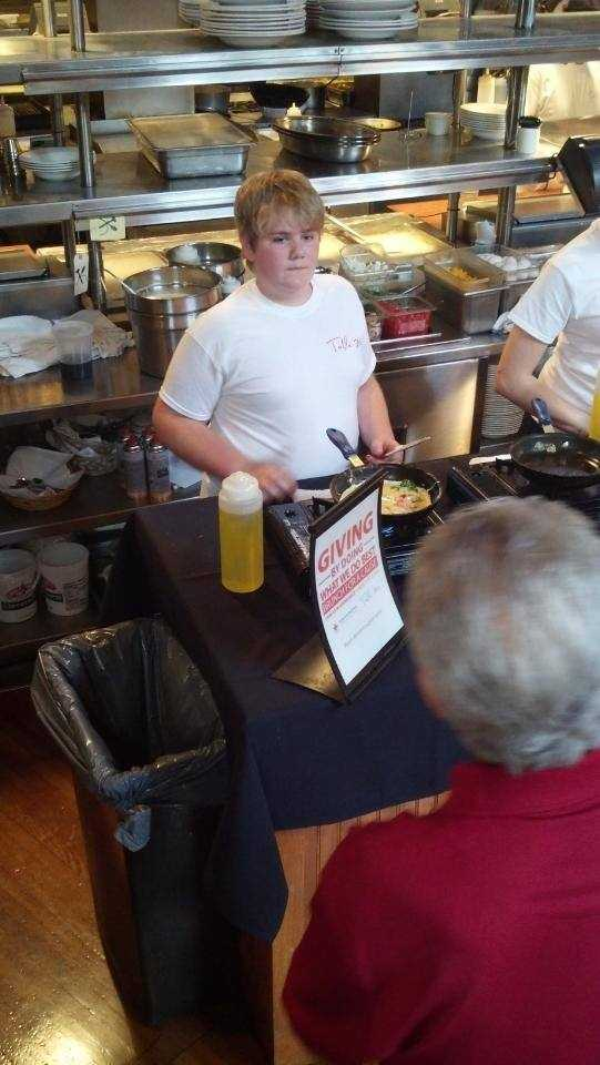 Chef Rodney's son at work at the omelet station