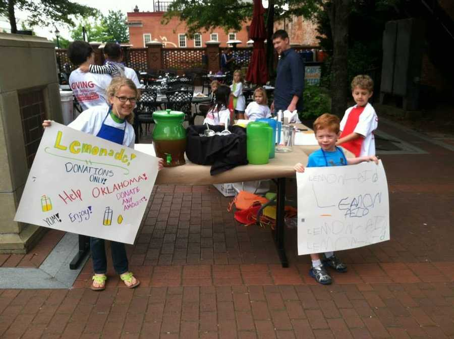 The children of staff members run a lemonade stand on Soby's patio