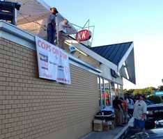 Greenville police, Greenville County deputies and Highway Patrol troopers sat on top of the Krispy Kreme Doughnut Shop to raise money for Special Olympics.