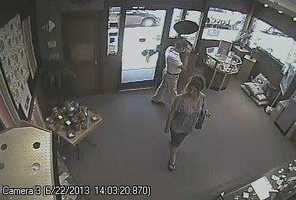 Police said a couple of minutes later this couple entered the store.