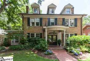 This 6 bedroom/5 ½ bath mansion is on historic Earle Street in Greenville.