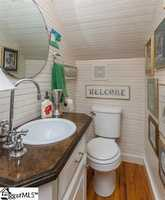 There are five full bath and one half bath in the home.