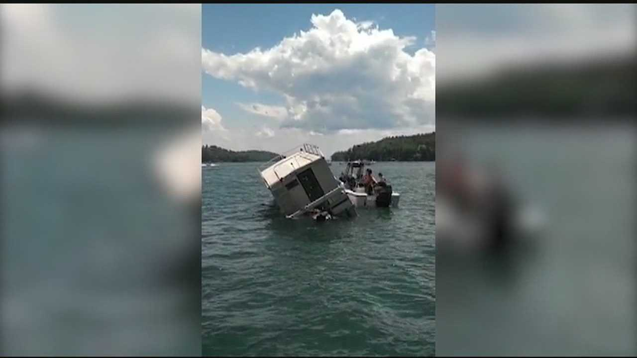 Several people escaped without injuries when a house boat sank on Lake Keowee.