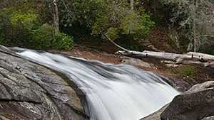 Turtleback Falls is in the Pisgah National Forest off Horsepasture River in North Carolina.