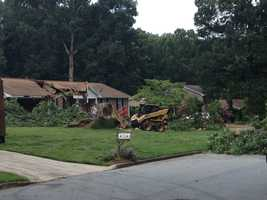 At 7 a.m. Monday a 100 foot tree fell on a home in Spartanburg County.
