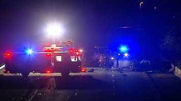 A mother was killed and her three children injured in a crash their father watched from another vehicle.