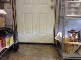 Crisco on the floor by the door.
