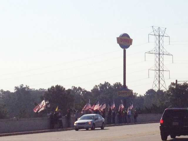 American Legion Post 200 of Boiling Springs gathered a group to hold flags on Highway 9 over I-85.