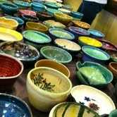 Potters throughout Asheville - and extensively from the River Arts District - make and donate bowls for the event each year.