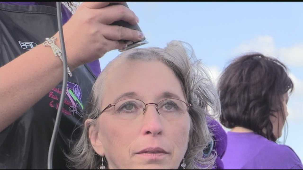 Kandy Kelley, the Pickens County coroner, had her head shaved Saturday as part of the annual Change Cancer with You Change event.