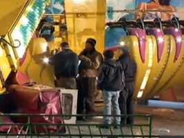 "Inspectors investigate the ride called ""The Vortex,"" where the accident happened about 9:15 p.m."
