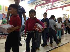 Members of Newspring Church gave a new pair of shoes to every child at Grove Elementary School.