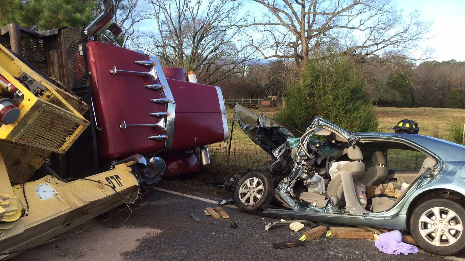 This wreck between a flatbed truck hauling a crane and a Toyota Camry is under investigation.