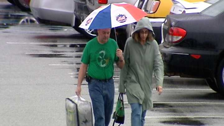 Rain affects holiday travel, shopping