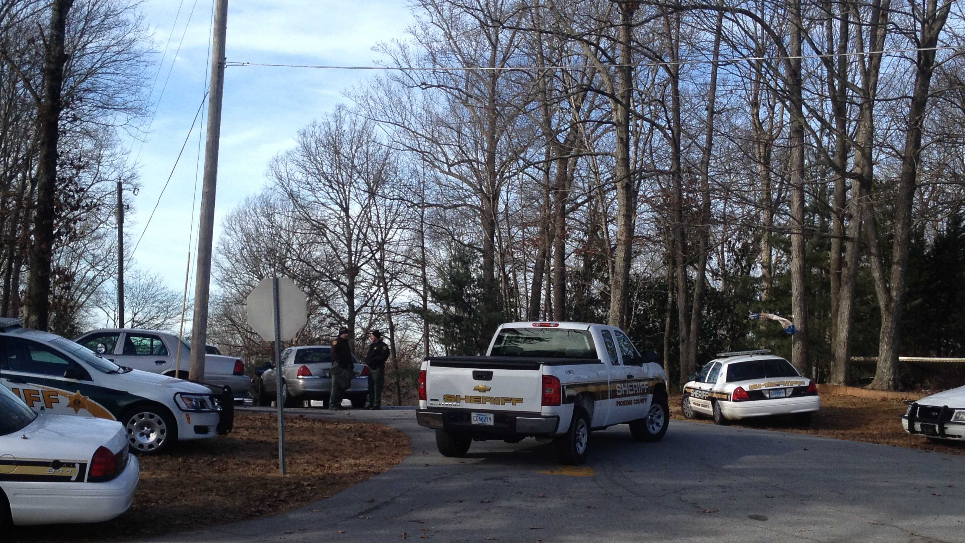 Deputies say a man has barricaded himself in a home after attacking his wife.