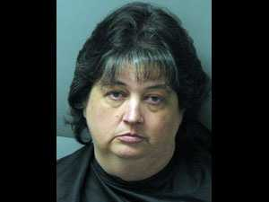 Angela Simpson: charged with 74 counts of financial identity fraud
