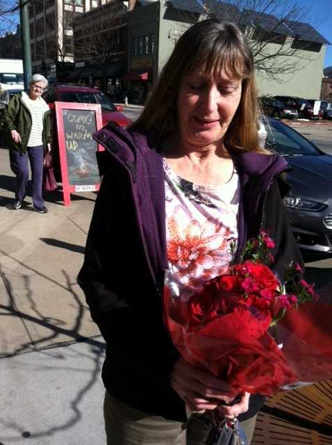 Aliska Tamera brought flowers to the cafe in Laurey Masterton's memory.
