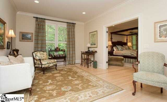 The master bedroom on main level has its own sitting room.