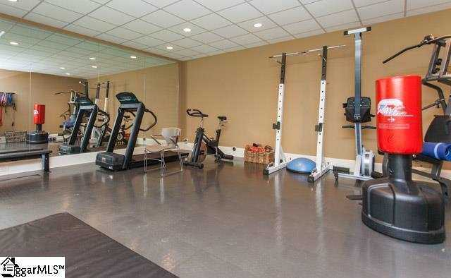 There is a large workout room in the home.