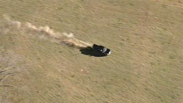 The suspect sped across fields, even crashing through a fence at one point.