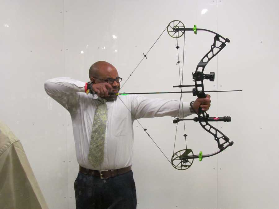Nigel Robertson picked up a bow and arrow to see if he could hit the target.