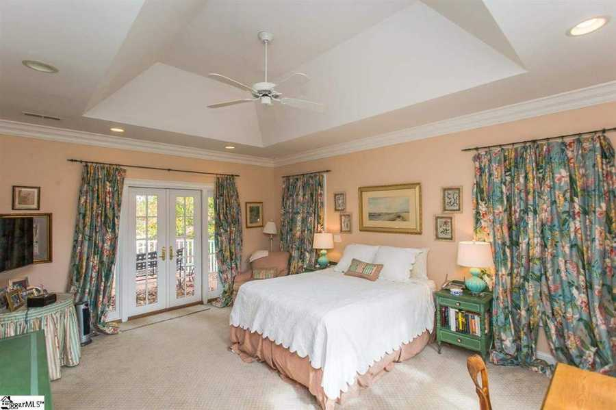 The estate home has five bedrooms, four full bathrooms and two half bathrooms.