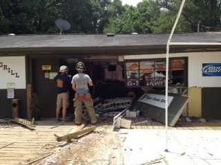 Anderson County deputies have responded to the Tiger Cove Grill after a car ran into the front of the restaurant and left.