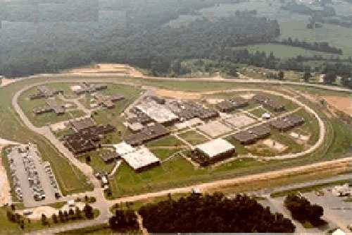 """In 1985, Joyce Bailey Mattox, of Spartanburg, pulled a gun on a chartered helicopter pilot and forced him to land Perry Correctional Institution, where a killer and two armed robbers climbed in before the chopper, under heavy fire, barely made it over the 12' fence. A guard was shot in the face during the prison break. They were caught a few days later. Mattox was sentenced to 40 years for air piracy and the others had time added to their existing sentences. She famously told WYFF, """"I did it for love."""""""