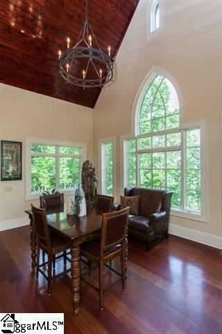 There is a vaulted wood ceiling in the large breakfast room.