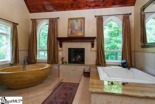 The master bath has wood vaulted ceiling, gas fireplace a limestone soaking tub, oversized jetted tub and large shower with multiple shower heads.