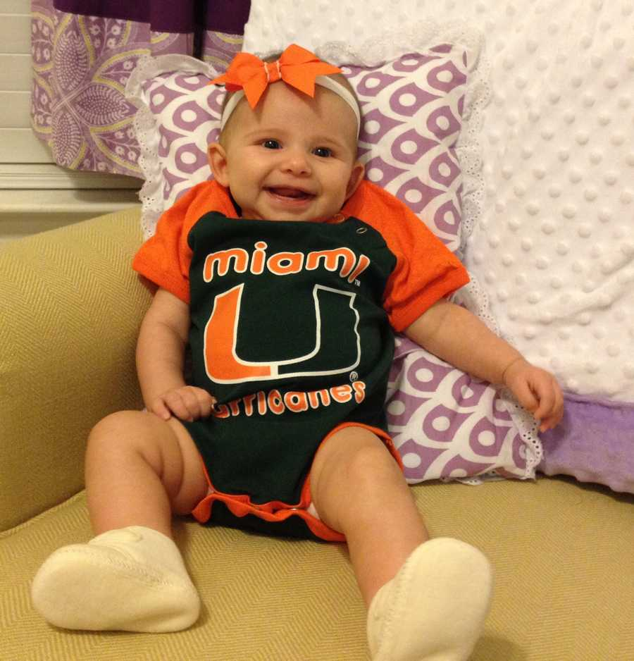 Angela and her mother both graduated from the University of Miami. Rooting for the Hurricanes is family tradition. This is Angela's baby girl rocking some Miami gear.