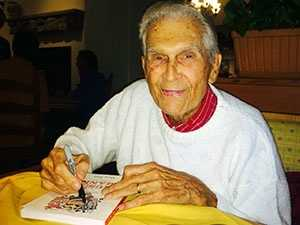 This may be one of the last photos taken of Mann in April 2014. He was signing a book for a fan at the Olive Garden in Anderson.