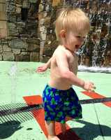 Pack up the kids and go to the fountain in front of The Lazy Goat in Downtown Greenville. It's right on the Reedy River below the restaurant. The kids will have a blast running through the water jets.
