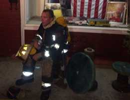 One of the 30 or so firefighters responding to the scene takes a brief break.