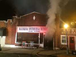 Smoke streamed out of the front doors of the business.