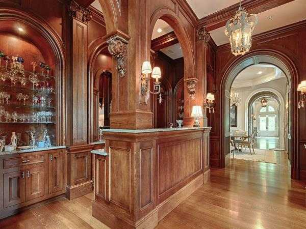 The entertainment area features a full-size oak bar.