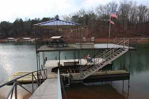 It also has a boat dock, fire pit and basketball court