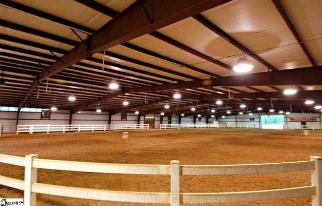 The property also features a horse arena.