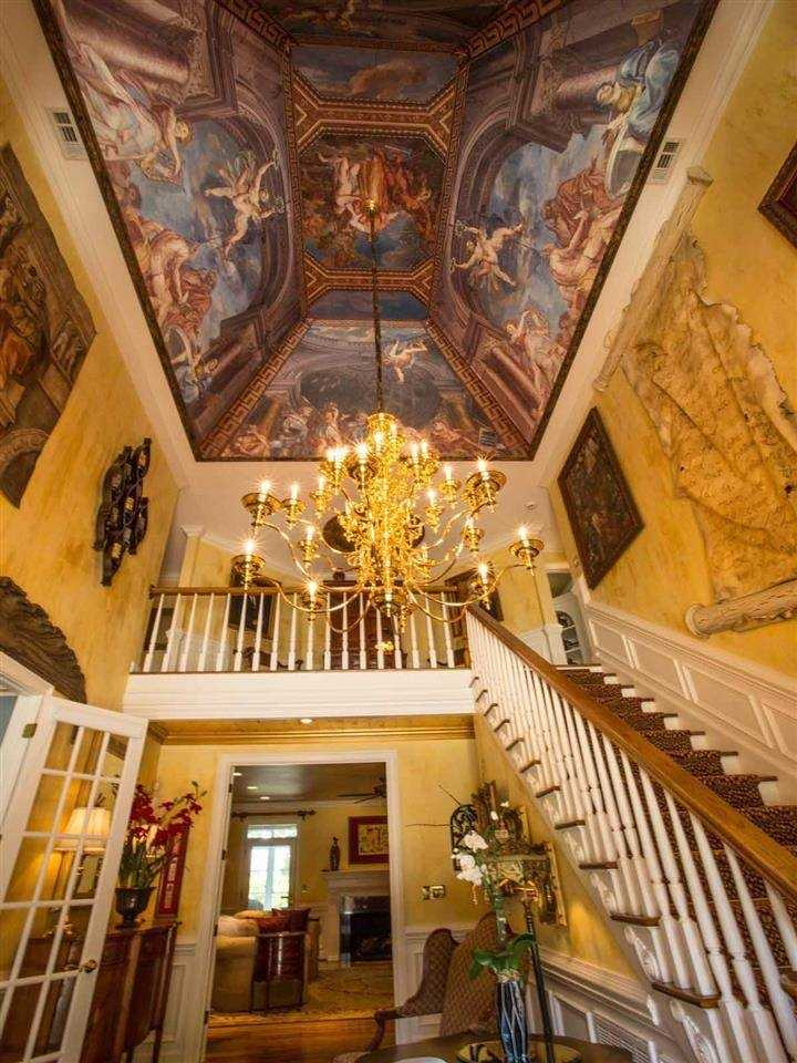 The home has hand painted ceilings. It has 5 bedrooms, 4 baths, and a bonus room.