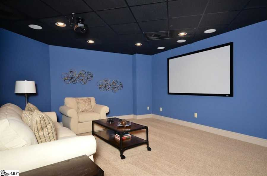The lower level features a large bonus room with fireplace, an exercise room with private bath, a private wine cellar and walk-in safe. It also has an extra large home theater with projector and screen.