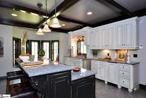 The kitchen features a butler's pantry, full refrigerator and freezer. The large keeping room with fireplace gives plenty of room to entertain while preparing a meal.