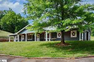 The 7 stall custom barn/ equestrian center is a highlight for all types of riding enthusiasts. This home is listed on realtor.com for $4,062,189.