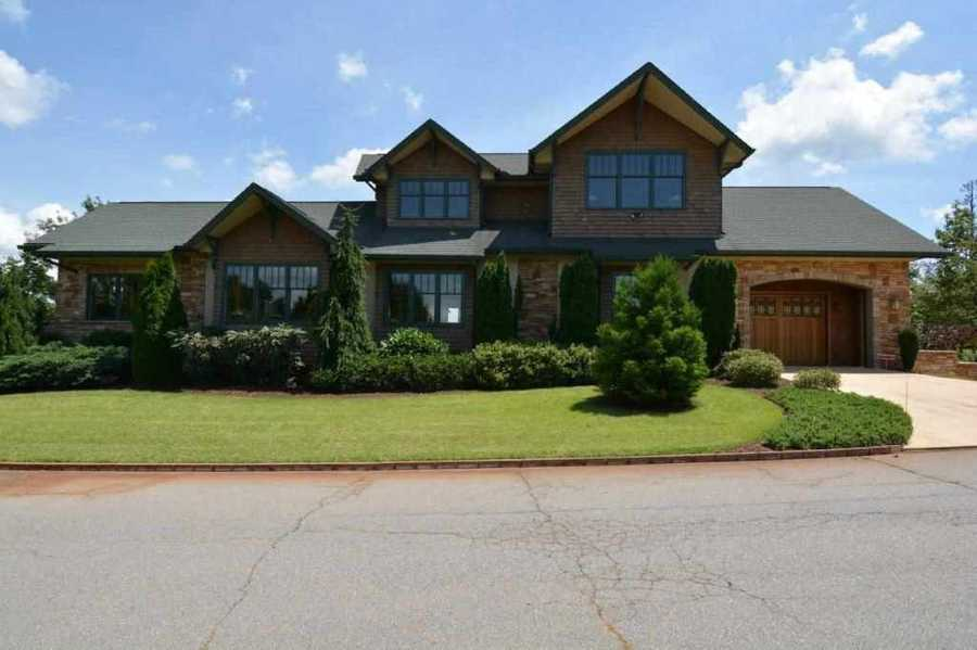 Pickens: This mountain top Craftsman home has views of Table Rock from the front and the night lights of Hartwell Ga on a clear night from the back