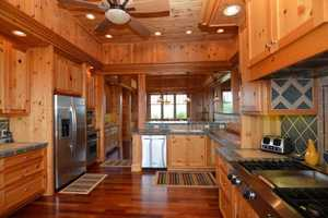 The home has a gourmet kitchen, Brazilian cherry floors and pine walls, ceilings and built-ins throughout.